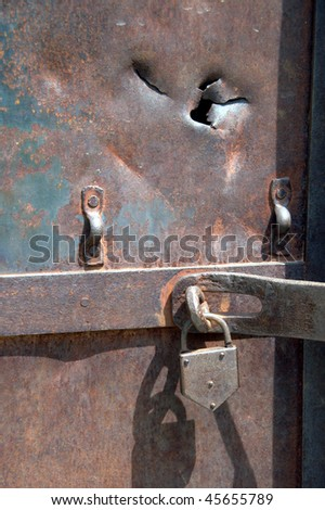 lock on an old and rusty iron door