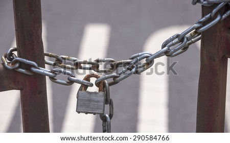 lock on gate for security - stock photo