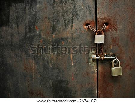 lock on rusty iron door - stock photo