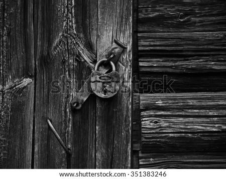 lock on the rotten wooden wall - stock photo