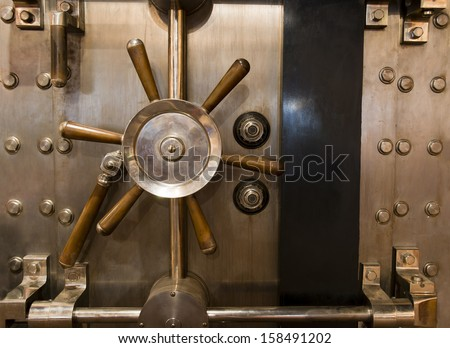 Locked bank vault door in retail store safe secure storage locker - stock photo