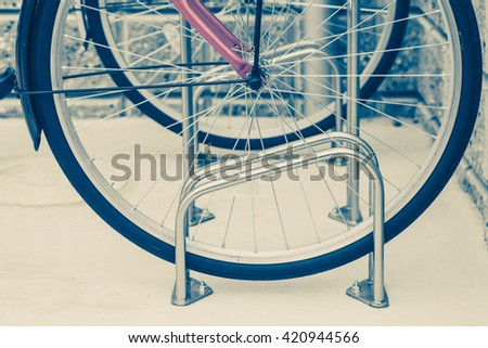 Locked bicycle at bicycle outdoor parking space