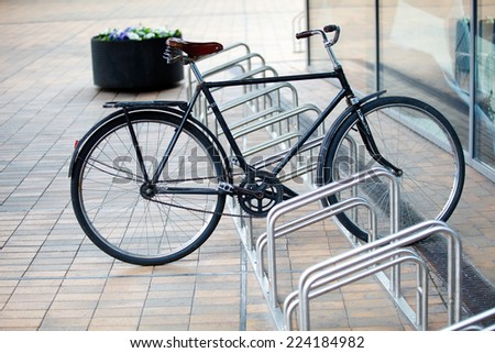 Locked bicycle at bicycle parking - stock photo