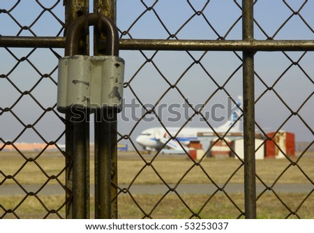 locked door to the airport - airport closed - stock photo