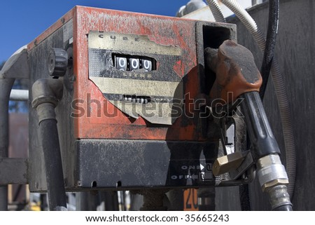 locked old dusty worn out fuel pump - stock photo