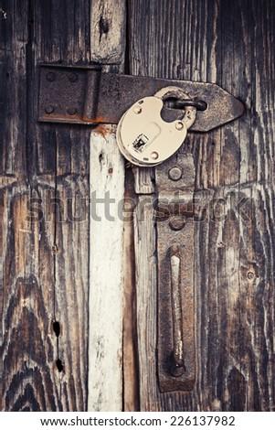 Locked old wooden door - stock photo