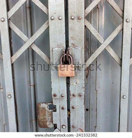 Locked on sliding steel door. - stock photo