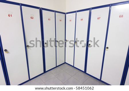 lockers numbered white and blue for clothing and personal items - stock photo