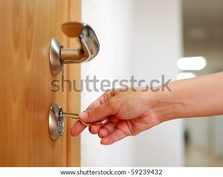 Locking up or unlocking door with key in hand & Door Lock Stock Images Royalty-Free Images \u0026 Vectors   Shutterstock Pezcame.Com
