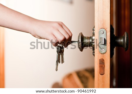 Locking up or unlocking door with key in hand & Locking Unlocking Door Key Hand Stock Photo (Royalty Free) 90461992 ...