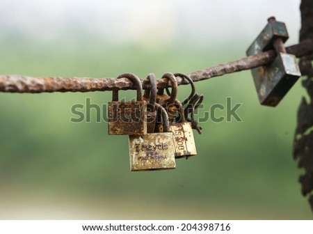 Locks on the fence of the Long Bien bridge. Lovers lock their love with the lock. - stock photo