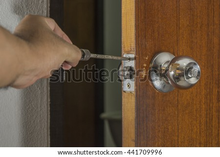 locksmith fix a old knob on wood door in house - can use to display or montage product or web - stock photo