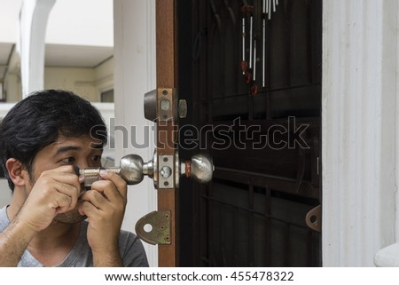 locksmith open the home door by his tools and his job technique - can use to display or montage on product - stock photo