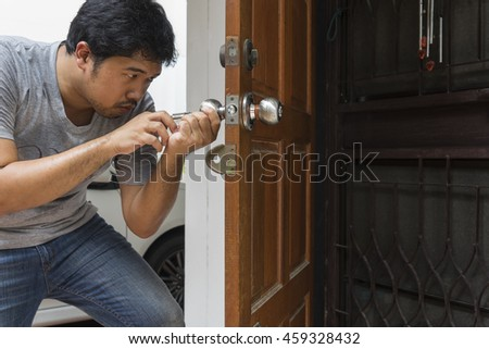 locksmith open the wood door by key maker tools at home - can use to display or montage on product - stock photo