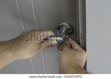 locksmith repair silver knob on gray door in the room - can use to display or montage on product - stock photo