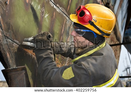 Locksmiths  Boilermakers  cleans  welds  on  ship's  hull - stock photo