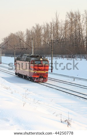 Locomotive on the snowy railway. WInter day