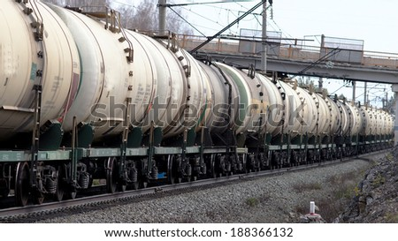 Locomotive with tanks should be on the railroad track.