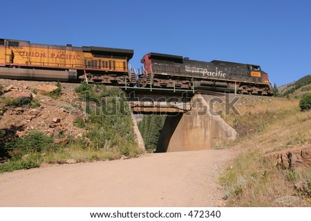 Locomotives powering up Rollins Pass, Colorado. - stock photo