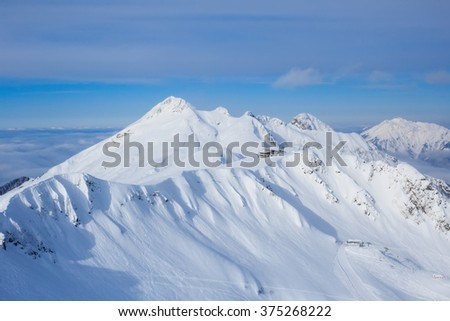 lodge nearby mountain peak covered with snow in caucasus mountains in ski resort Rosa Khutor Sochi - stock photo