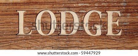 Lodge on a rustic wooden board.