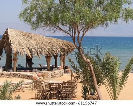 Lodge overlooking Sea - stock photo