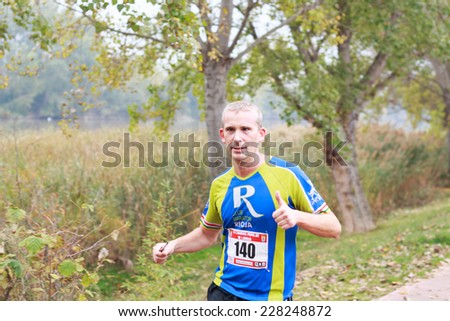 LODOSA - SPAIN - NOVEMBER 02: A athlete in the first run solorunners in Lodosa. Celebrated in Lodosa on November 02, 2014 - stock photo