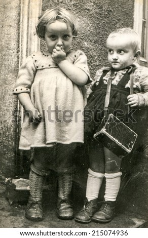 LODZ, POLAND, CIRCA JULY 1961: Vintage photo of little sisters