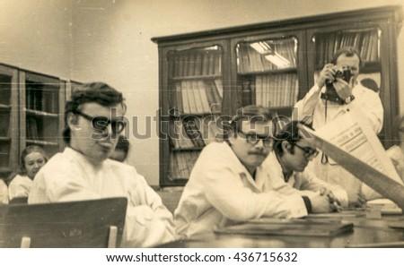 LODZ, POLAND, CIRCA 1970'S: Vintage photo of medicine school students during workshops - stock photo