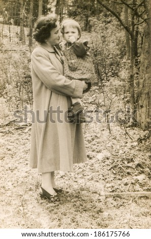 LODZ, POLAND, CIRCA 1950's: Vintage photo of mother with little daughter