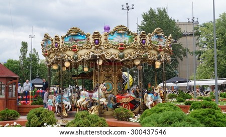 LODZ,POLAND - 26 JULY 2015 :Children's carousel - Manufaktura the evening