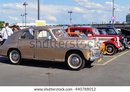 LODZ, POLAND, JUNE 19 2016 : Beautiful retro cars. Rally fans of retro cars in Lodz.The historic  FSO Warszawa M-20  and an icon of Polish automobile - stock photo