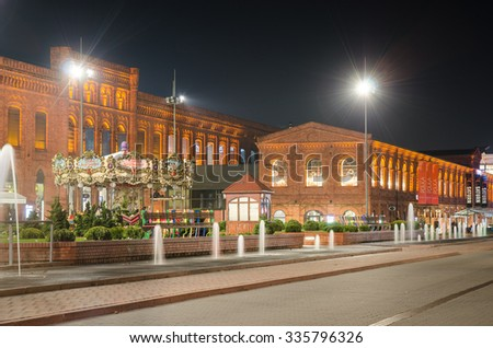 LODZ, POLAND - NOVEMBER 2, 2015; Manufaktura square and its restaurants. Shopping and entertainment center organized in XIXth century textile factory.