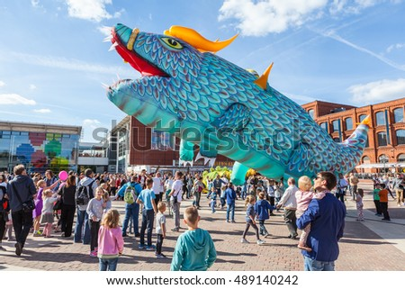 Lodz, Poland, September 25, 2016, Manufaktura: Dragons party as part of International Festival of Animation Art, great kite dragon surrounded by a crowd of children