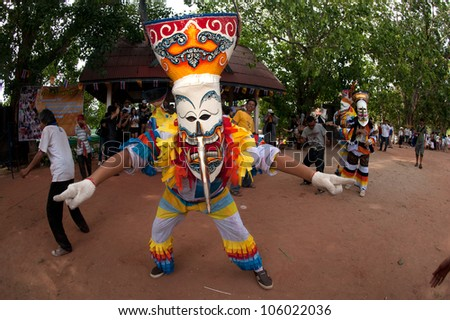 "LOEI ,THAILAND-JUNE 23: Ghost Mash Festival (Phi Ta Khon) is a type of masked procession celebrated on Buddhist merit- making holiday known in Thai as""Boon Pra Wate"" at Dan Sai district,June 23,2012"