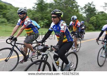 "LOEI, THAILAND June 5,2016:People ride bicycles in ""Tour of Isan Loei Claassic 2â?�,  the road bicycle race through Loei  province in Thailand"