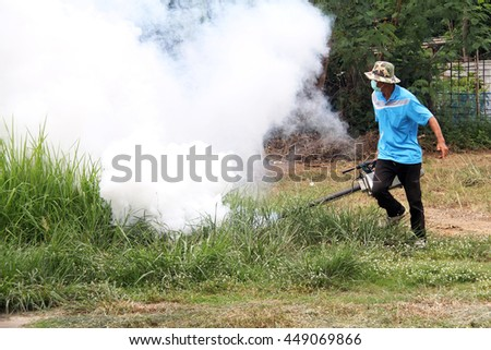 LOEI, THAILAND JUNE 17: Unidentified man fogging chemical to anti mosquitos on JUNE 17, 2016 in LOEI, Thailand.