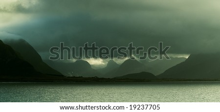 Lofoten islands, Dark clouds, Mountains and Fjord, Norway - stock photo