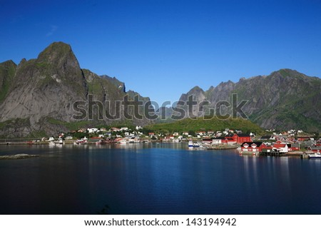 Lofoten islands unesco heritage small fishing villages with wooden huts ferry fjord Lofoten Islands tourism Lofoten Islands norway eco-friendly North Sea Arctic Circle cod fishing - stock photo