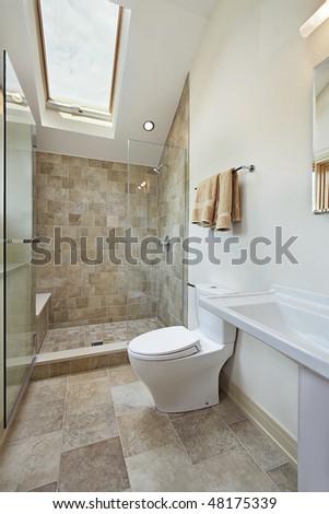 Loft bathroom with stone shower and skylight - stock photo