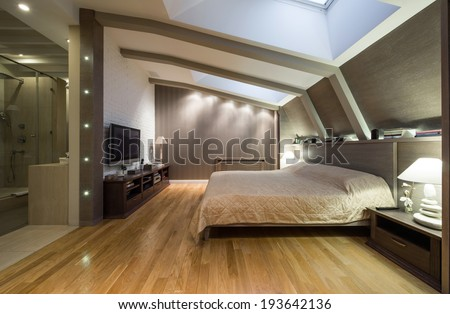 Loft bedroom with private bathroom - stock photo
