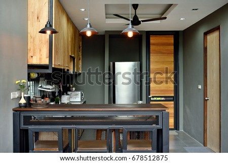 Loft Kitchen Counter Bar, Steel And Wood Structure.There Are Beautiful  Decorative Lamps.