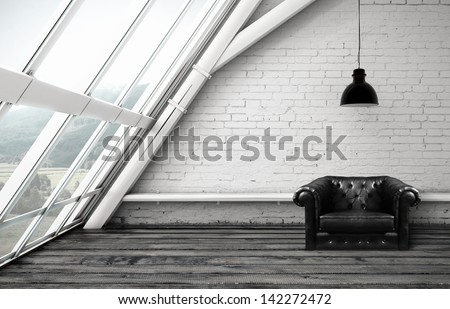 loft with window and black leather chair - stock photo
