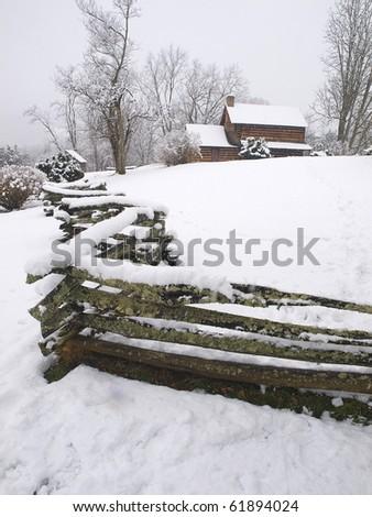 log cabin in snow - stock photo