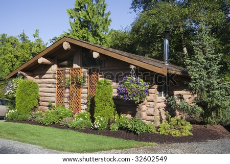 Log Cabin with Hanging Basket, Canada - stock photo