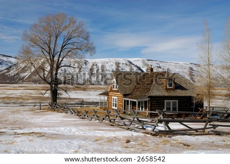 Log House on National Elk Refuge in Wyoming - stock photo