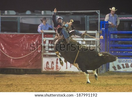 LOGANDALE , NEVADA - APRIL 10 : Cowboy Participating in a Bull riding Competition at the Clark County Fair and Rodeo a Professional Rodeo held in Logandale Nevada , USA on April 10 2014