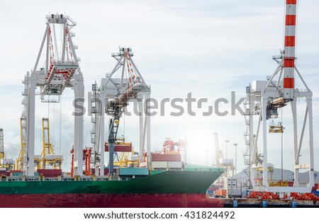 Logistic Import Export background, Port cranes working in sea port, Crane of freight dock,Container Cargo freight ship with working crane bridge in shipyard. - stock photo