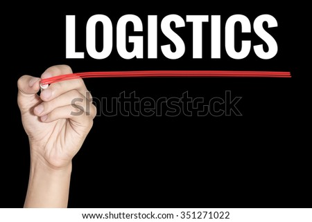 Logistic word writing by men hand holding highlighter pen with line on dark background - stock photo