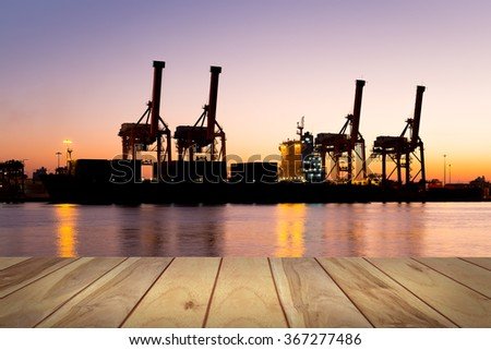 Logistics and transportation of crane and cargo freight ship and cargo container at port for logistics and transportation background.   - stock photo